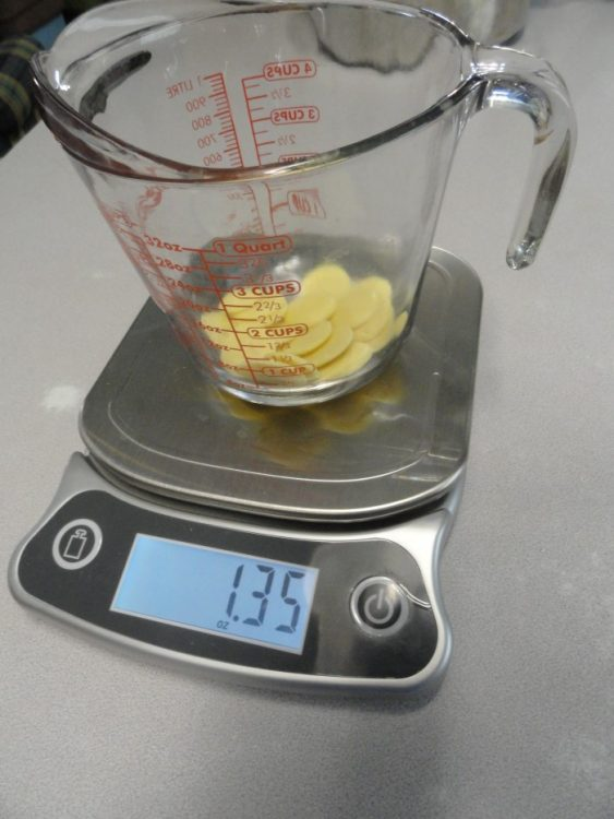Cocoa butter and oil being weighed on a food scale