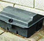 An example of a safety trap, that keeps the rats from dragging poison into places also shared by pets and poultry.